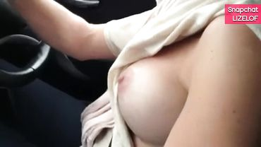 Cougar flashes her tits and sucks a dick while driving a car