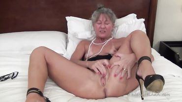 Granny with small tits masturbating just for you and she loves doing it