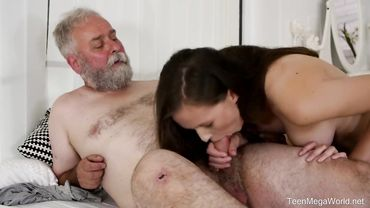 Young babe with beautiful natural tits sucks an older man off before riding him
