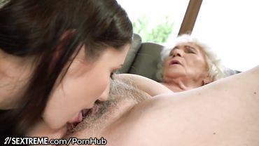 Kinky granny loves having a hot young brunette lick her hairy pussy