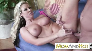 Glamorous blonde cougar with big tits gives a wet blowjob and gets railed