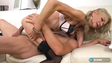 Classy blonde granny in erotic lingerie impaled on a big young dick