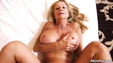 Busty mature blonde spreads her legs to have both of her holes rammed