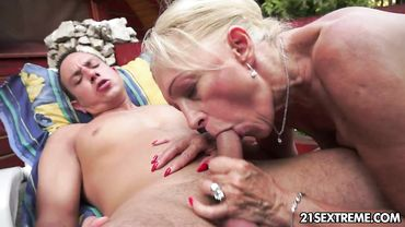 Horny blonde granny sucks a stiff young shaft before riding it vigorously