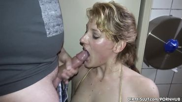 Blonde babe gets a bukkake session with a bunch of dudes shooting cum