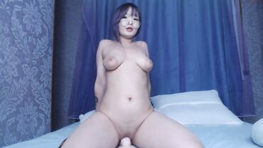 Busty amateur Korean hottie with big tits riding dildo on webcam in glasses