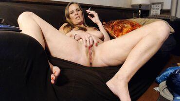 Blonde MILF mom is smoking as she rubs her sweet cunt roughly