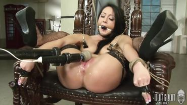 Ravishing brunette tied up to a chair and pleasured with various sex toys