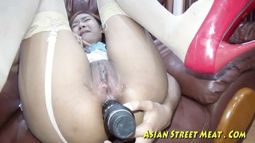 Kinky Asian chick takes a massive dildo in her ass before hardcore anal