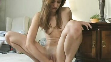 Tiny Russian in heels fists her ass before shoving a dildo in it