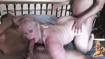 Chubby blonde granny in a slutty french maid outfit enjoys hardcore gangbang