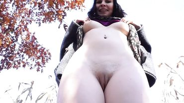 Brunette doing some erotic masturbation in public and loving every moment of it