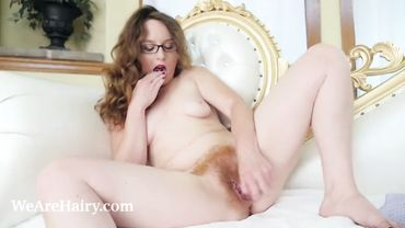 Redhead slut has an insanely hairy pussy and she loves to play with it