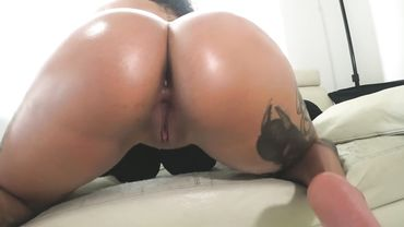 Big ass Latina performs a striptease to reveal her fat and tattooed butt