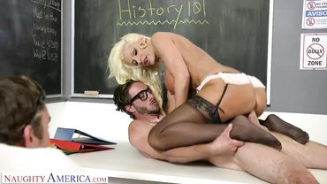 Brittany Andrews gives a blowjob and receives cum on tits while husband watches