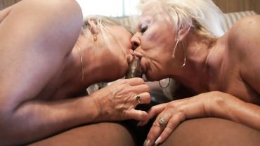 Two lusty grannies give a double blowjob and ride in an interracial threesome