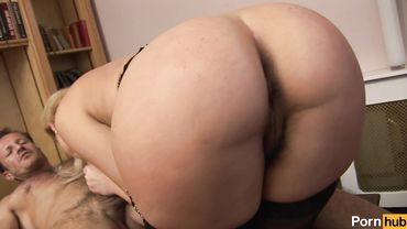 MILF blonde with trimmed pussy rides a huge boner on the office table