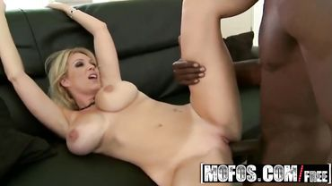 Blonde MILF chokes on a big black cock before riding it passionately