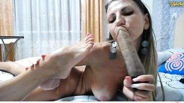 Lusty Russian amateur brunette fingers herself and slobbers on a big dildo