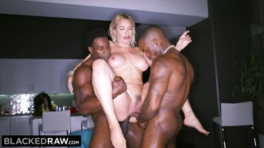 MILF is having her ass fucked as black dicks bang her in a threesome