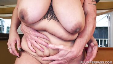 Fat mature brunette with massive tits enjoys fingering before sucking cock and riding