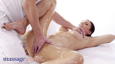 Busty brunette gets her whole body oiled on a massage before she gets fucked