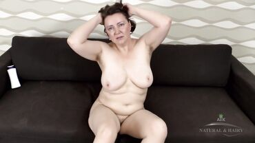 Fat grandma with short hair solo masturbates and plays with her boobs
