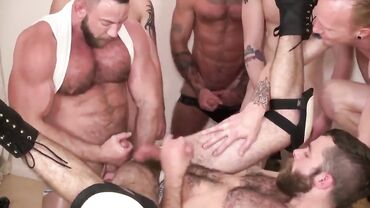 Masculine guys enjoy drinking piss and licking asses in a rough gay orgy
