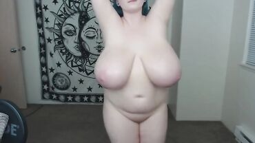 Curvy amateur MILF plays with her massive natural tits on a webcam