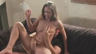 Classy MILF enjoys erotic smoking while having her shaved pussy licked and rammed