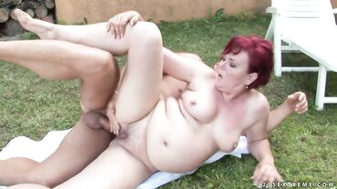 Mature redhead whore takes a dick in her old fat pussy outdoors