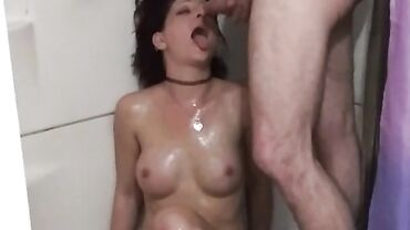 Slutty brunette takes a rough fuck and throat piss in the shower