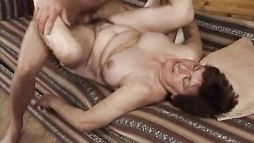 Chubby naked mature European woman fucks hardcore in her wet hairy pussy