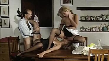 European cougar in stockings and high heels fucks her friend and her husband