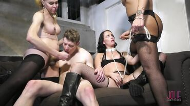 Booty shemales in stockings fuck a girl and a guy in an orgy