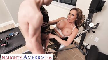 American babe with nice tits fucks a young stud in a gym