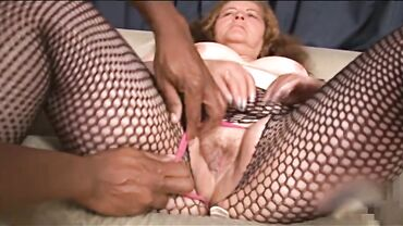 Granny amateur in fishnet stockings found a young guy to fuck her hard