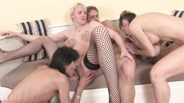 Three skinny European grannies seduce a younger guy into a hardcore foursome
