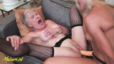 Gorgeous blonde seduces a horny granny and fucks her with a strapon