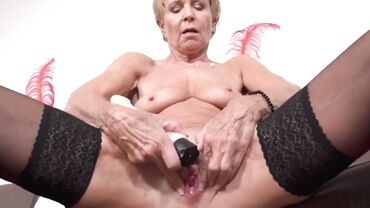 Skinny granny in stockings masturbates and plays with her toys HD