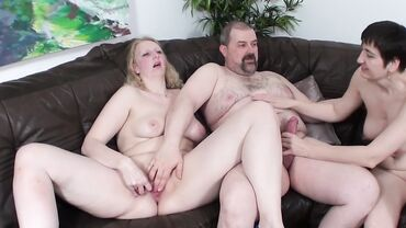 Two horny busty mature naughties fuck in a threesome on a couch