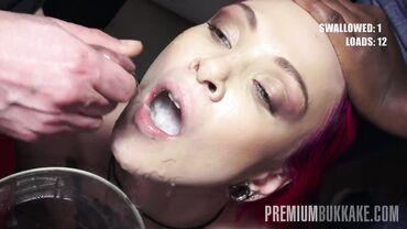 Insatiable redhead tart enjoys multiple facials in a steamy hot bukkake gangbang
